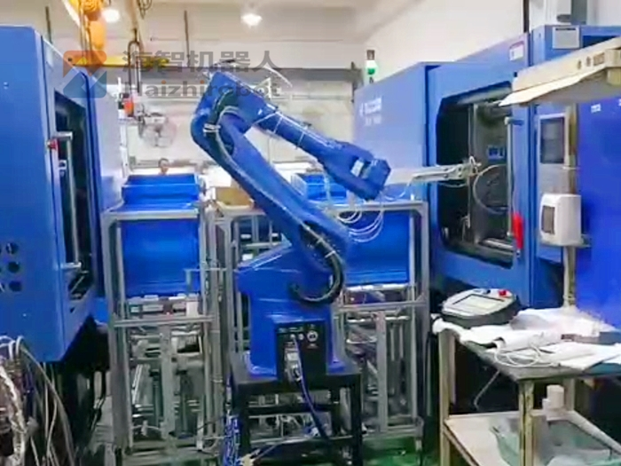 机器人自动取注塑件 机械手注塑机(一拖二自动生产线)(图1)